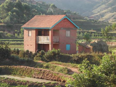 Farmhouse among the intensively cultivated rice terraces of Betafo, west of Antsirabe