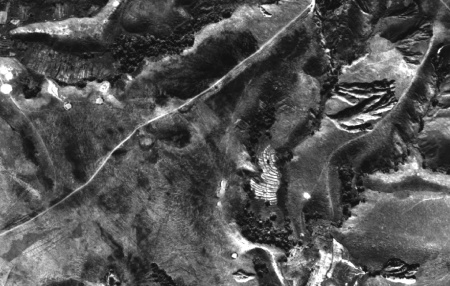 Detail of 1991 air photo for Amparihivato (north of Tsiroanomandidy), showing rice fields in former riparian wetlands, ox cart track, and lavaka erosion gully
