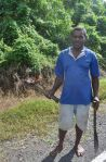 Farmer heading to his fields with fire stick, Tailevu, Viti Levu