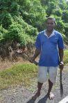 Farmer heading to his fields with fire stick, Tailevu, Viti Levu